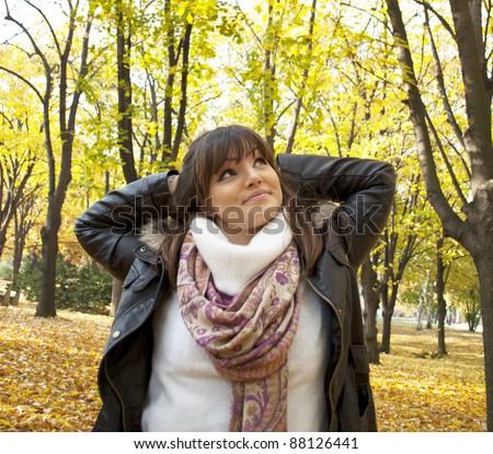 Portrait of a happy woman enjoying nature - stock photo