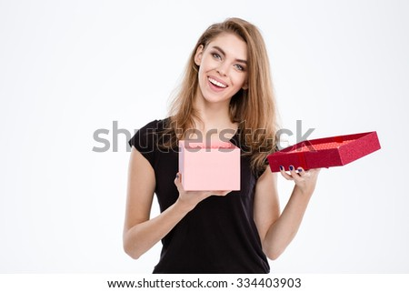 Portrait of a happy woman opening gift box isolated on a white background - stock photo