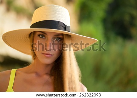 Portrait of a happy woman  with a warmth light and background - stock photo
