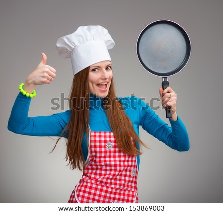Portrait of a happy woman with the pan - stock photo