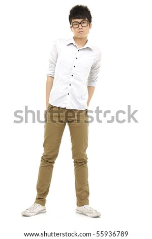 Portrait of a happy young boy standing - stock photo