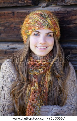 Portrait of a happy young brunette outdoor in the countryside. - stock photo
