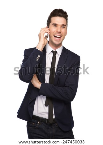 Portrait of a happy young business man talking on mobile phone - stock photo