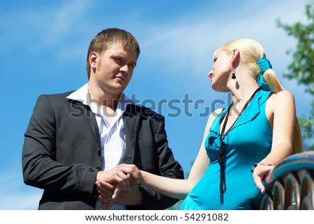 portrait of a happy young couple in park - stock photo