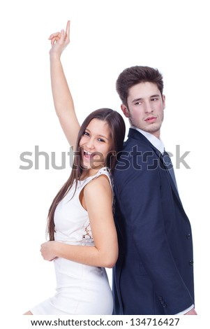 Portrait of a happy young couple standing back to back - stock photo