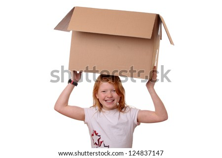 Portrait of a happy young girl carrying a large box - stock photo