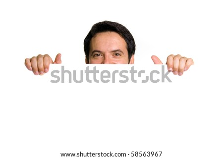 Portrait of a happy young guy holding blank billboard - stock photo