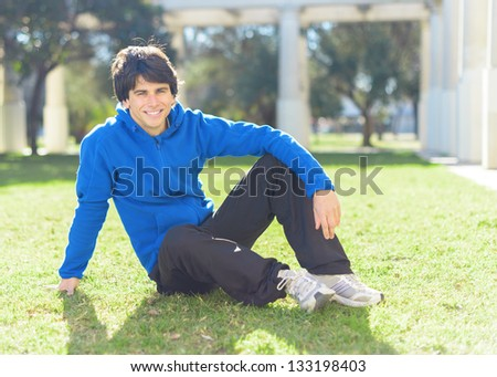 Portrait Of A Happy Young Man; Outdoors - stock photo