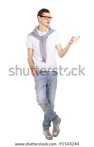 Portrait of a happy young man pointing at something interesting on white background - stock photo