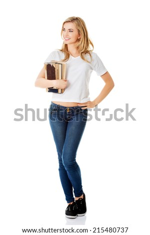 Portrait of a happy young student woman. - stock photo