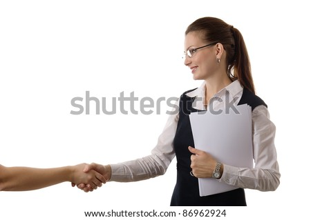 Portrait of a happy young woman offering a handshake against white background - stock photo