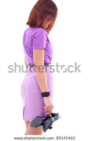 Portrait of a happy young woman standing on white background - stock photo
