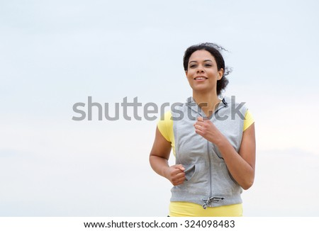 Portrait of a healthy african american woman running - stock photo