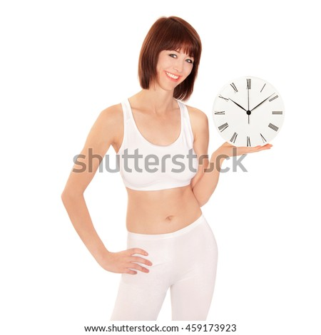 Portrait of a healthy young woman holding a watch, isolated on white studio background - stock photo
