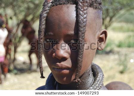 Portrait of a himba boy - stock photo
