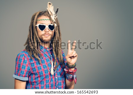 Portrait of a hippie young man in spectacles. - stock photo