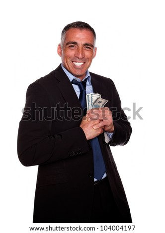 Portrait of a hispanic executive holding plenty of cash money while show it on isolated background - stock photo