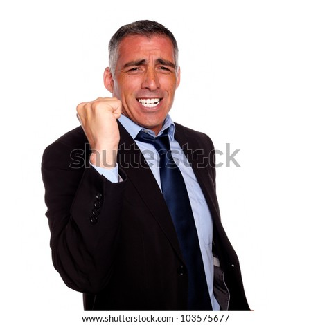 Portrait of a hispanic senior businessman celebrating a victory on isolated background - stock photo