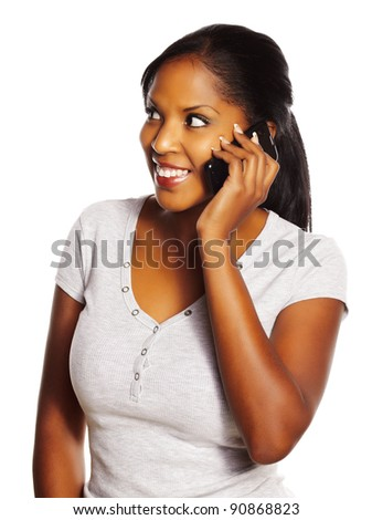 Portrait of a isolated young pretty black woman using a mobile phone. - stock photo