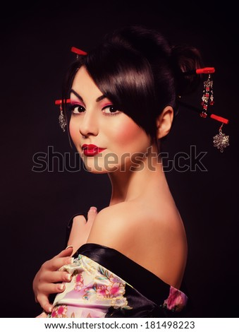 Portrait of a Japanese geisha woman - stock photo