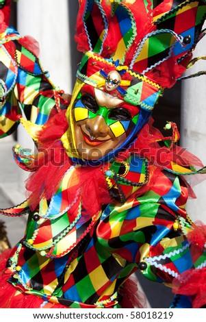 Portrait of a Joker in costume at the Venice Carnival, Italy. - stock photo