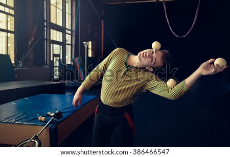 Portrait of a juggler at the circus school - stock photo