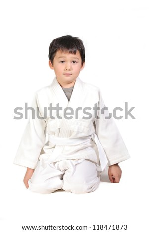 portrait of a karate kid posing isolated on white background - stock photo