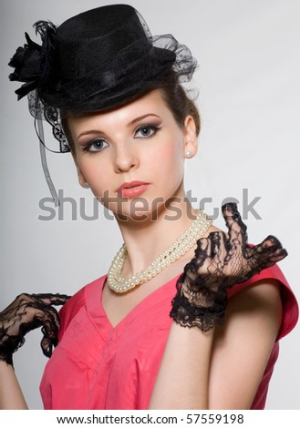 portrait of a lady in a hat, with beads and lace gloves. Retro - stock photo