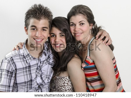 Portrait of a Latin family smiling - stock photo