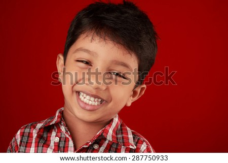 Portrait of a laughing boy - stock photo