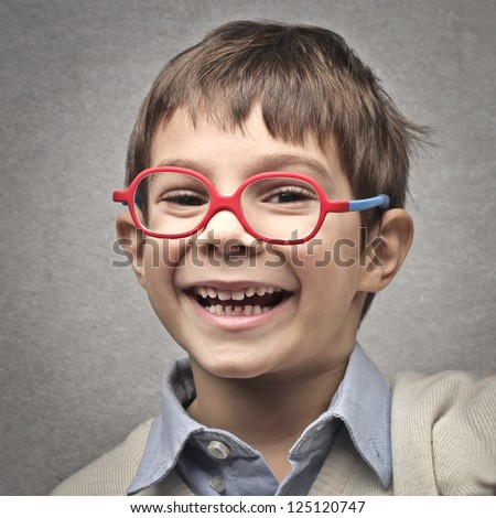 Portrait of a laughing child - stock photo