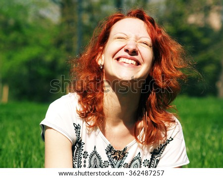 portrait of a laughing girl In sunshine - stock photo