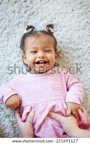 Portrait of a laughing toddler - stock photo