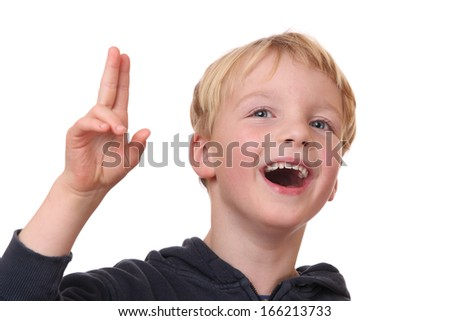 Portrait of a laughing young boy on white background - stock photo