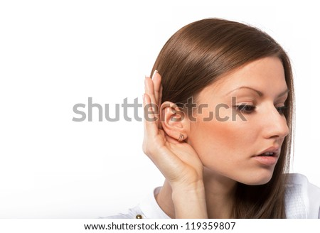 Portrait of a listening young woman, on white background - stock photo