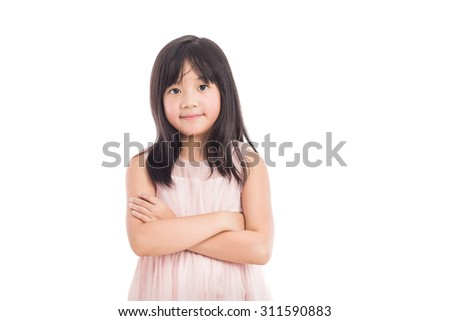 portrait of a little asian girl standing with folded hands over white background - stock photo