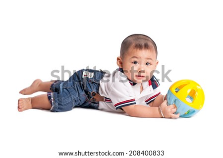 Portrait of a little baby boy playing with toys - stock photo