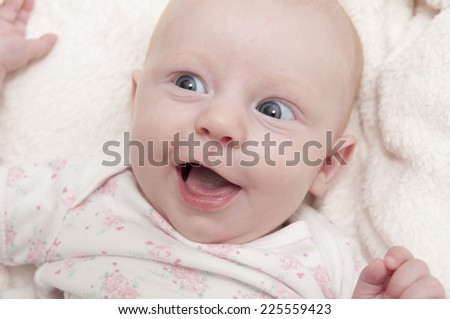Portrait of a little baby girl smiles and happy - stock photo
