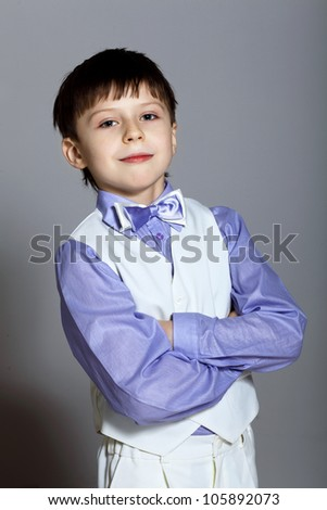Portrait of a little boy dressed for a celebration - stock photo