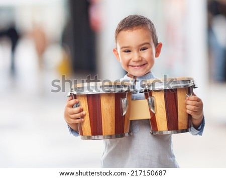 portrait of a little boy holding a drum - stock photo