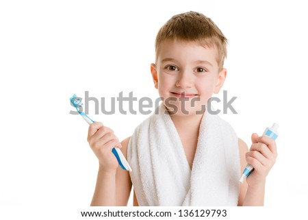 Portrait of a little boy holding a tooth brush over white background - stock photo