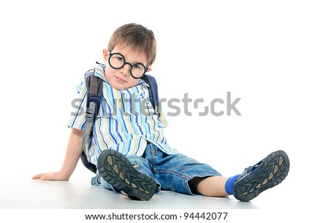 Portrait of a little boy in spectacles. Isolated over white background. - stock photo