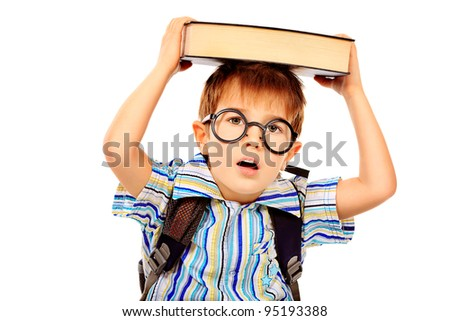 Portrait of a little boy in spectacles with a book. Isolated over white background. - stock photo