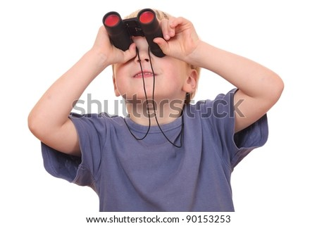 Portrait of a little boy looking through binoculars on white background - stock photo