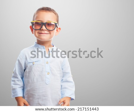 portrait of a little boy wearing retro sunglasses - stock photo