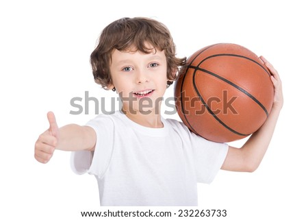Portrait of a little boy with a basketball on a white background. - stock photo