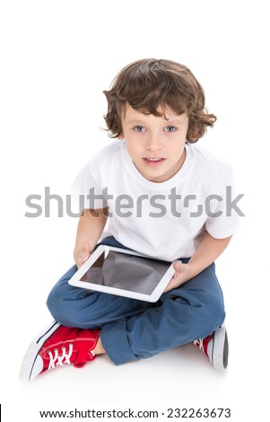 Portrait of a little boy with tablet, isolated on white background. - stock photo