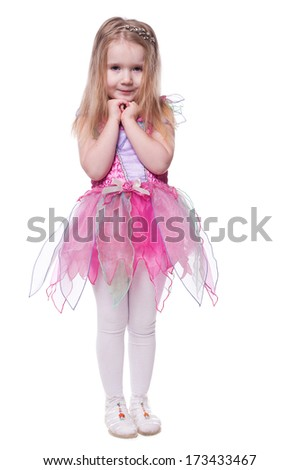 portrait of a little cute girl in a beautiful dress isolated on white background - stock photo