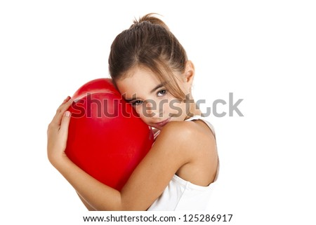 Portrait of a little girl embracing a red balloon, isolated on white background - stock photo