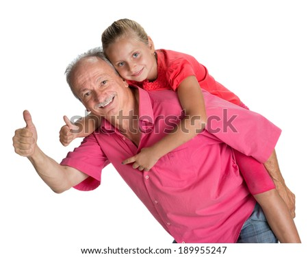 Portrait of a little girl enjoying piggyback ride with her grandfather on a white background - stock photo